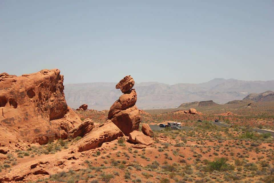 A desert scene with red rocks and mountains - Valley of Fire State Park, NV