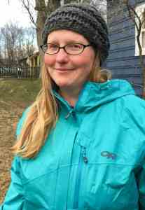 Me, wearing a turquoise rain jacket