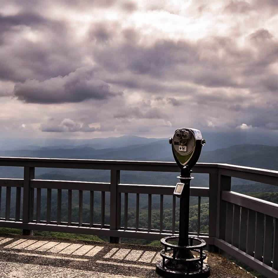 Binoculars and the mountainous view at the Blowing Rock.