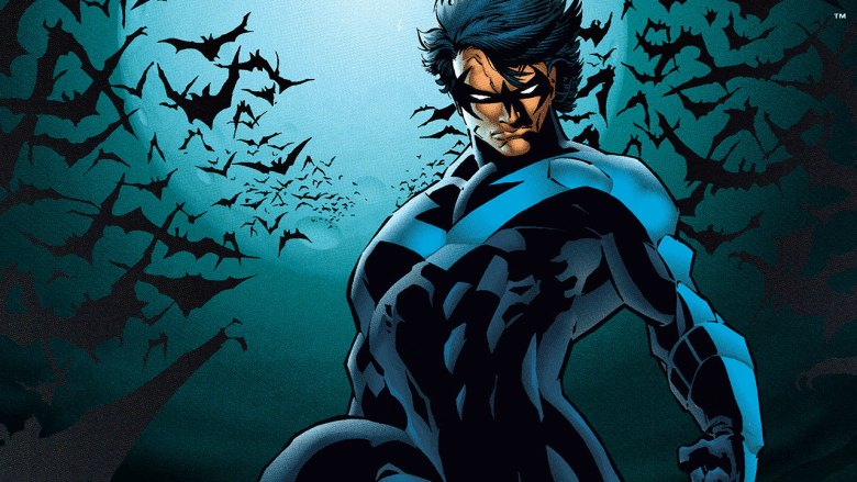 Nightwing stands in front of dark sky