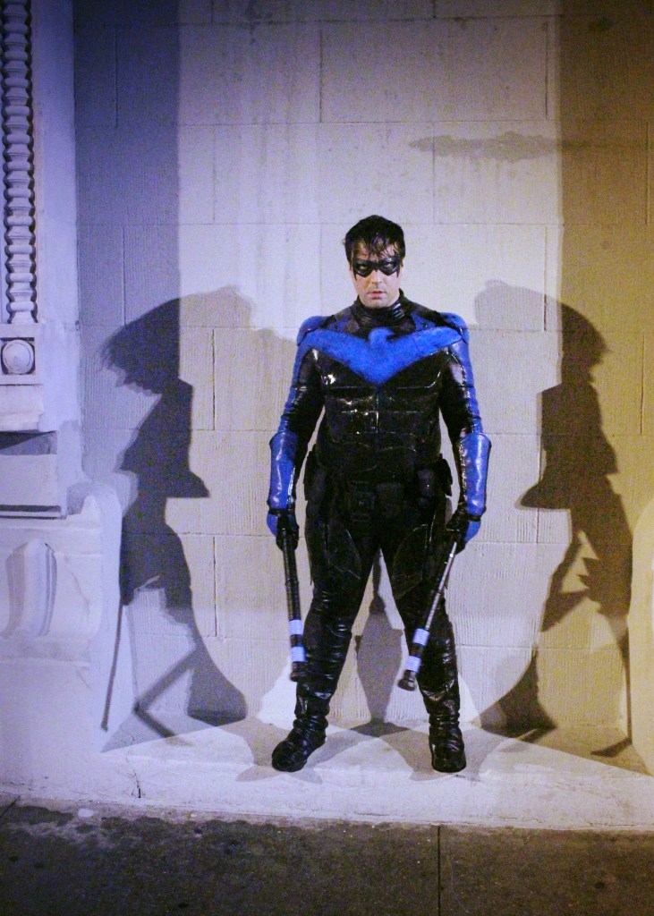 Nightwing's in the rain, ready to take on the enemy.