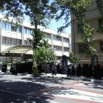 Woman waiting at the entrance of Tehran University