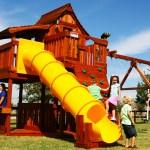 mustang, tube slide, lemonade, cabin, rock wall, wooden swing set, swing set, swings, slide, swing set for kids, kids, children, play, playground, playset, sets, accessories, backyard swing set