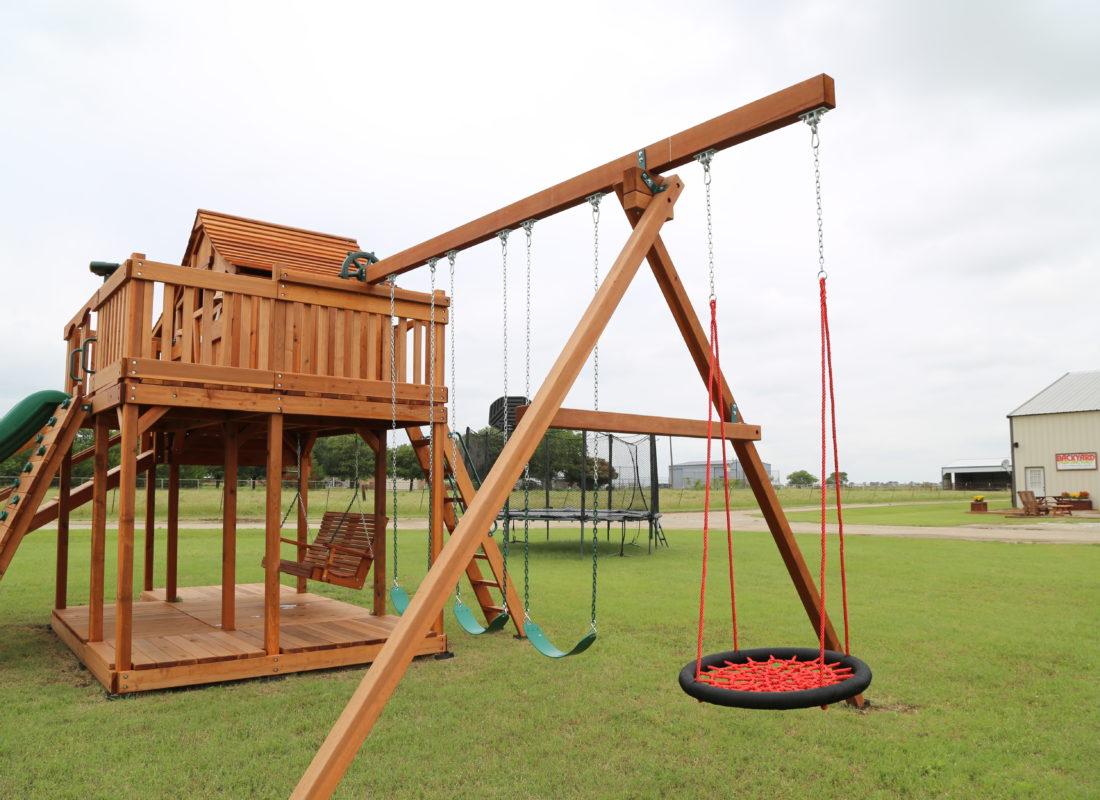 fort stockton, upper cabin, orbit swing, belt swings, half shack, wrap around porch, porch swing
