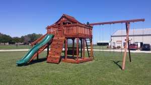 fort stockton, justin factory, porch swing, slide, ramp, rock wall, swings, justin store, backyard fun factory store, swing sets, playsets