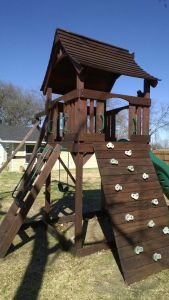 playset, swing set, swingset, rock wall, stain