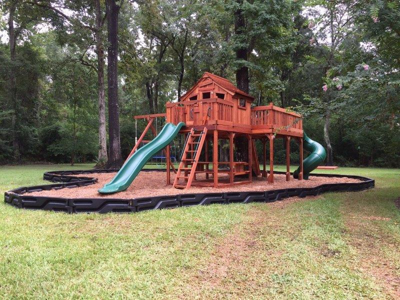 One of our many redwood playsets, this Backyard Fun Factory Fort Stockton swing set design features a tree deck, two slides, swings, and more.