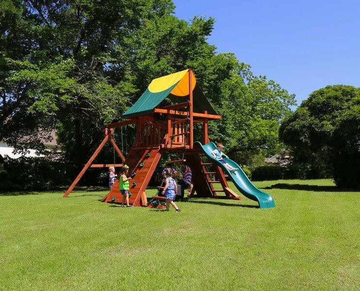 rustler, swing set, tarp roof, rockwall, swings, tire swing, slide, playset, backyard swing set