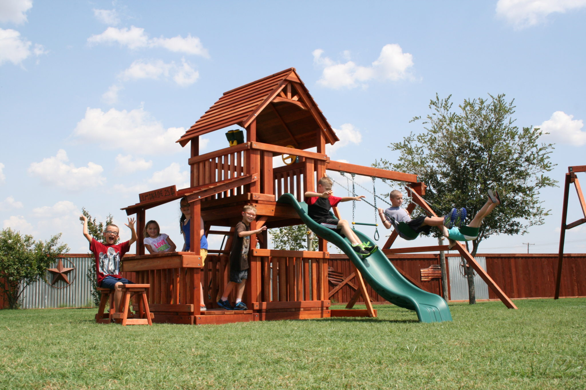 This 6 Foot Fort Davis Redwood Playset Features A Slide, A Swing Set, And