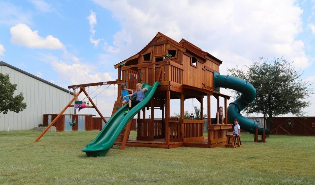 cabin, Fort Ticonderoga, lemonade, playset, rock wall, slide, Tri-Level, tube slide, toddler swing, trapeze bar, punching bag, outdoor playset, backyard landscape