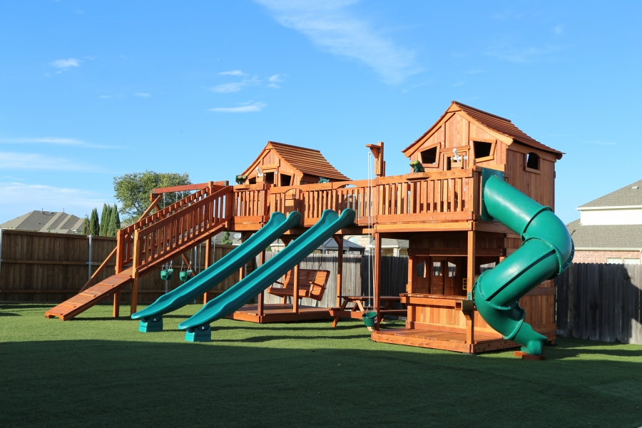 fort ticonderoga playset  bridged to fort stockton swing set. bridge is a monkey bar ridge with rave slides and toy accessories. Outdoor playset has boardwalk, lower cabin with built in lemonade counter, adult porch swing and swings.