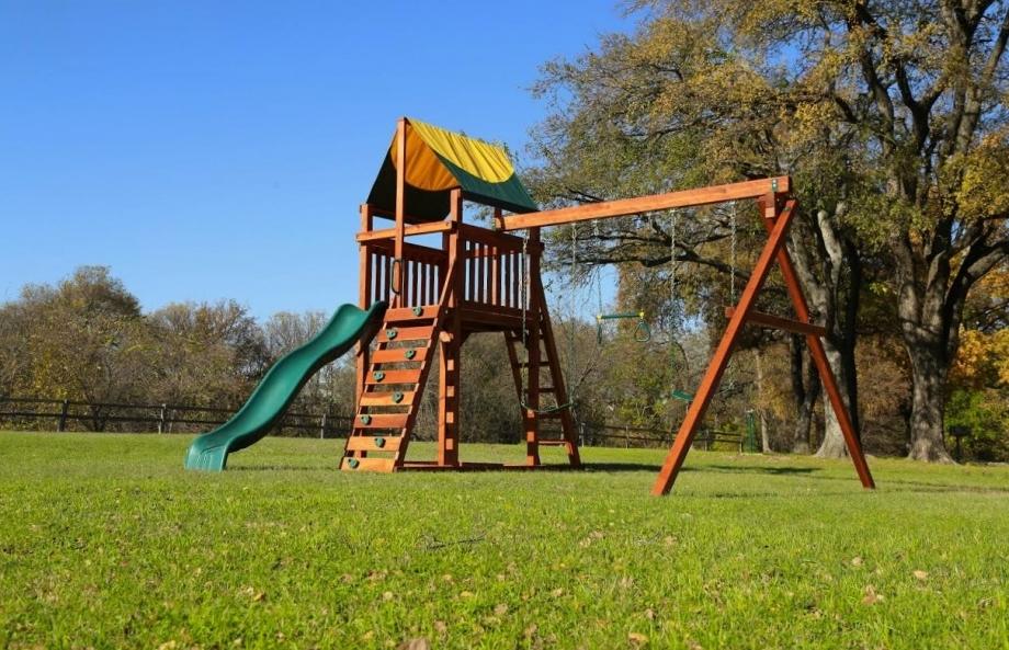 belt swings, ladder, playset, rock wall, slide, swing set, tarp roof, trapeze bar, wrangler, outdoor playset