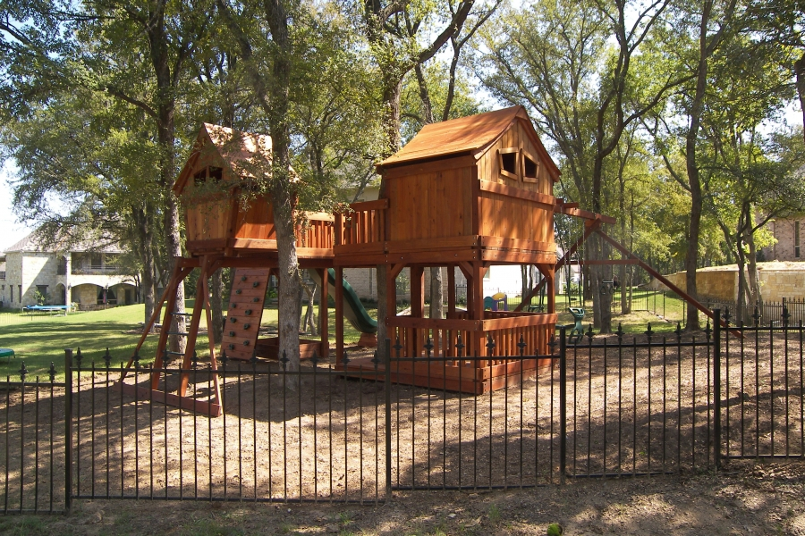 belt swings, cabin, fort, fort stockton, fun, fun deck, glider, monkey bar, monkey bar bridge, rave slide, rock wall, swing beam, trapeze bar, tree, tree platform, wooden playset