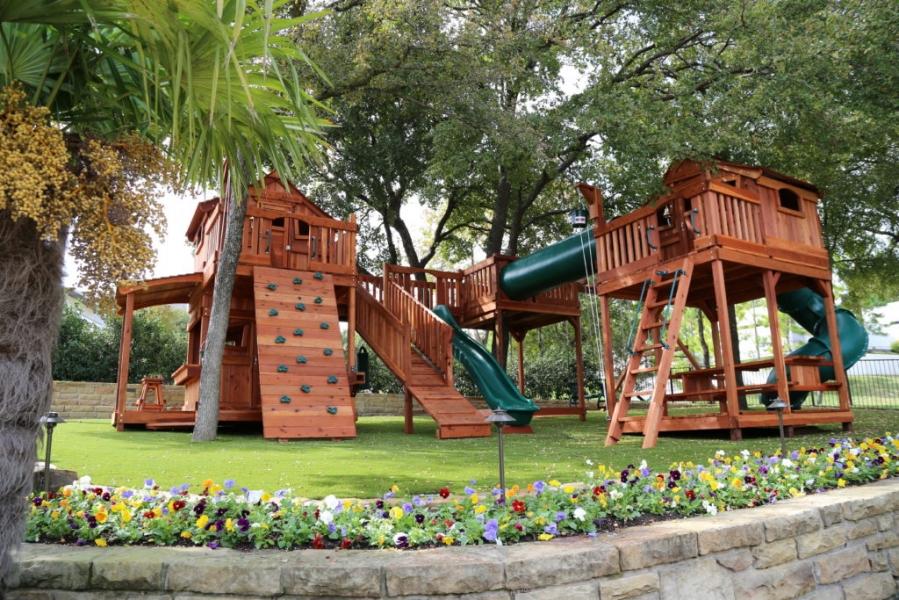 bridges, cabins, crawl tube, crawl tubes, fort, glider, lemonade stand, rock walls, slide, slides, swing set, swings, tree deck