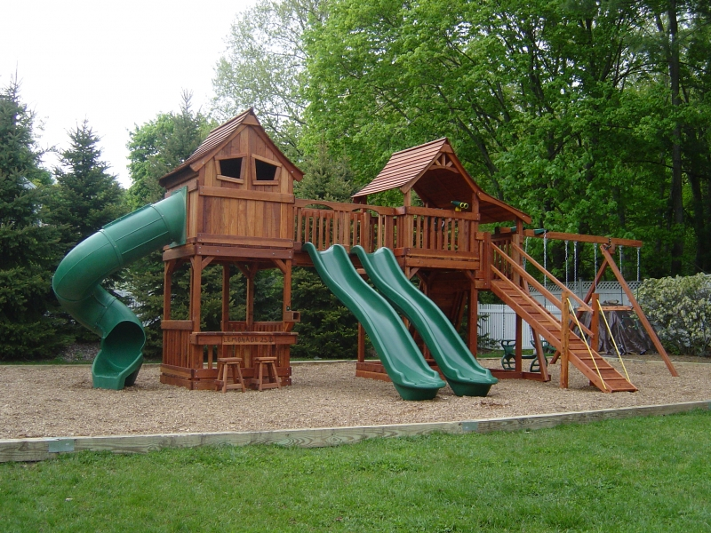 mustang, playset, swing set, rave slide, spiral slide, ramp, lemonade counter, belt swings, glider, sandbox, rock wall, trapeze bar, deck ladder