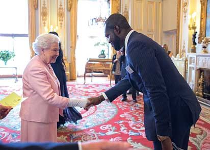 Idahosa-Linus with the queen