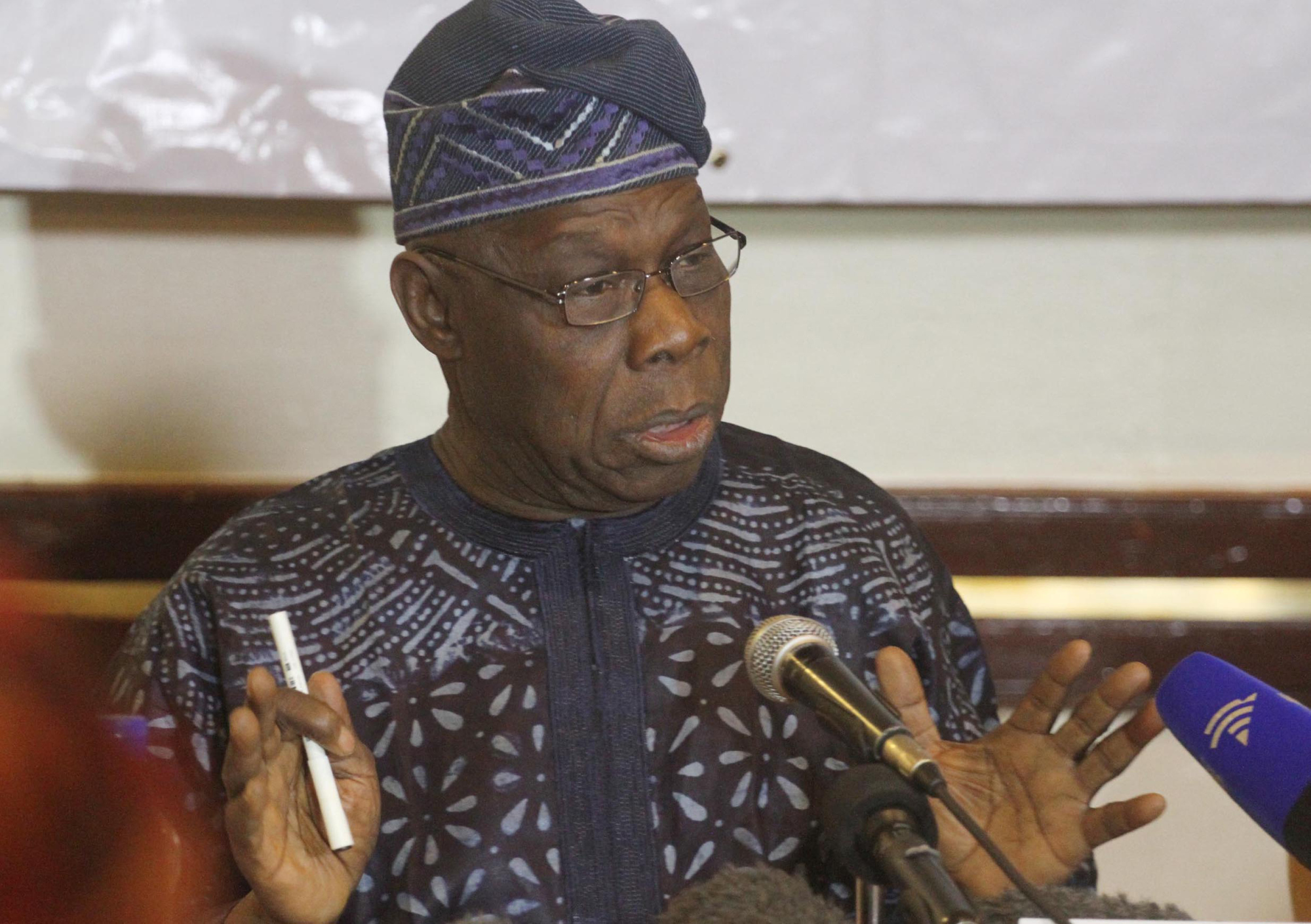 "Former Nigerian President Olusegun Obasanjo, head of the AU's 70-member election observer mission in Zimbabwe speaks to media in Harare Friday, Aug. 2, 2013.  Obasanjo said voting in the country itself was peaceful but the observers noted ""incidences that could have been avoided and even tended to have breached the law.'' (AP Photo)"