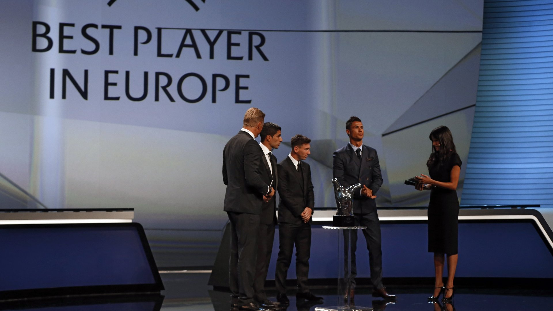 FC Barcelone Argentinian striker Lionel Messi (2ndL) his Urugayan teammate Luis Suarez (2ndL) and Real Madrid's Portuguese striker Cristiano Ronaldo (2ndR)  take part in the awarding ceremony for the Best Men's player in Europe at the end of the UEFA Champions League Group stage draw ceremony, on August 27, 2015 in Monaco. AFP PHOTO / VALERY HACHE        (Photo credit should read VALERY HACHE/AFP/Getty Images)