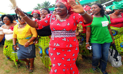 Uche Ekwunife acknowledging cheers from supporters