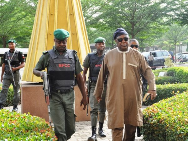 Alex badeh escorted to court by police