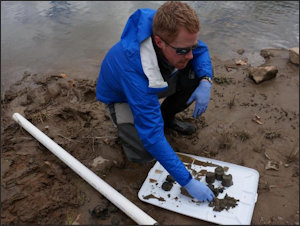 A North Carolina riverkeeper inspects testing samples of coal ash taken from the Dan River.