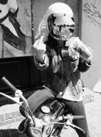 girl moto with middle finger up