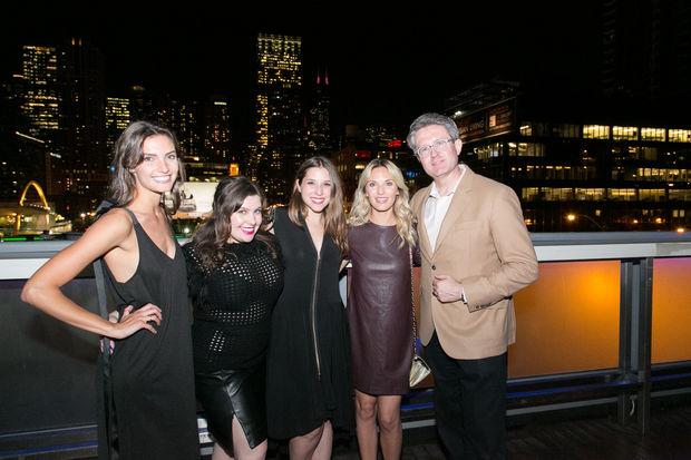 Sarah Perkins (center) with her DesignerShare team