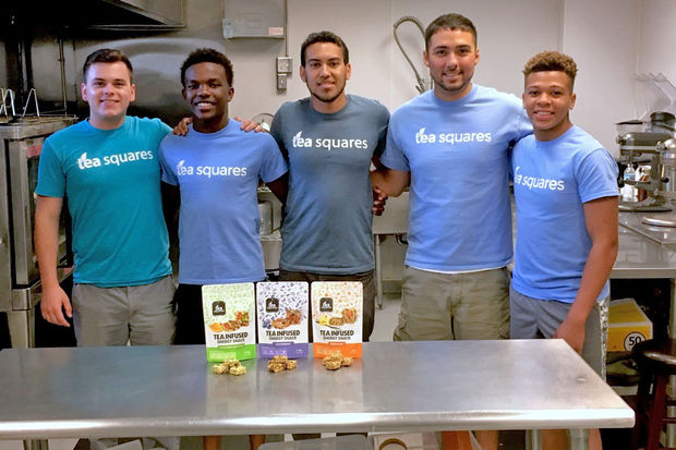 Jordan Buckner, (center), with his business partner Isaac Lozano (on his left) and their three fellows from the summer.