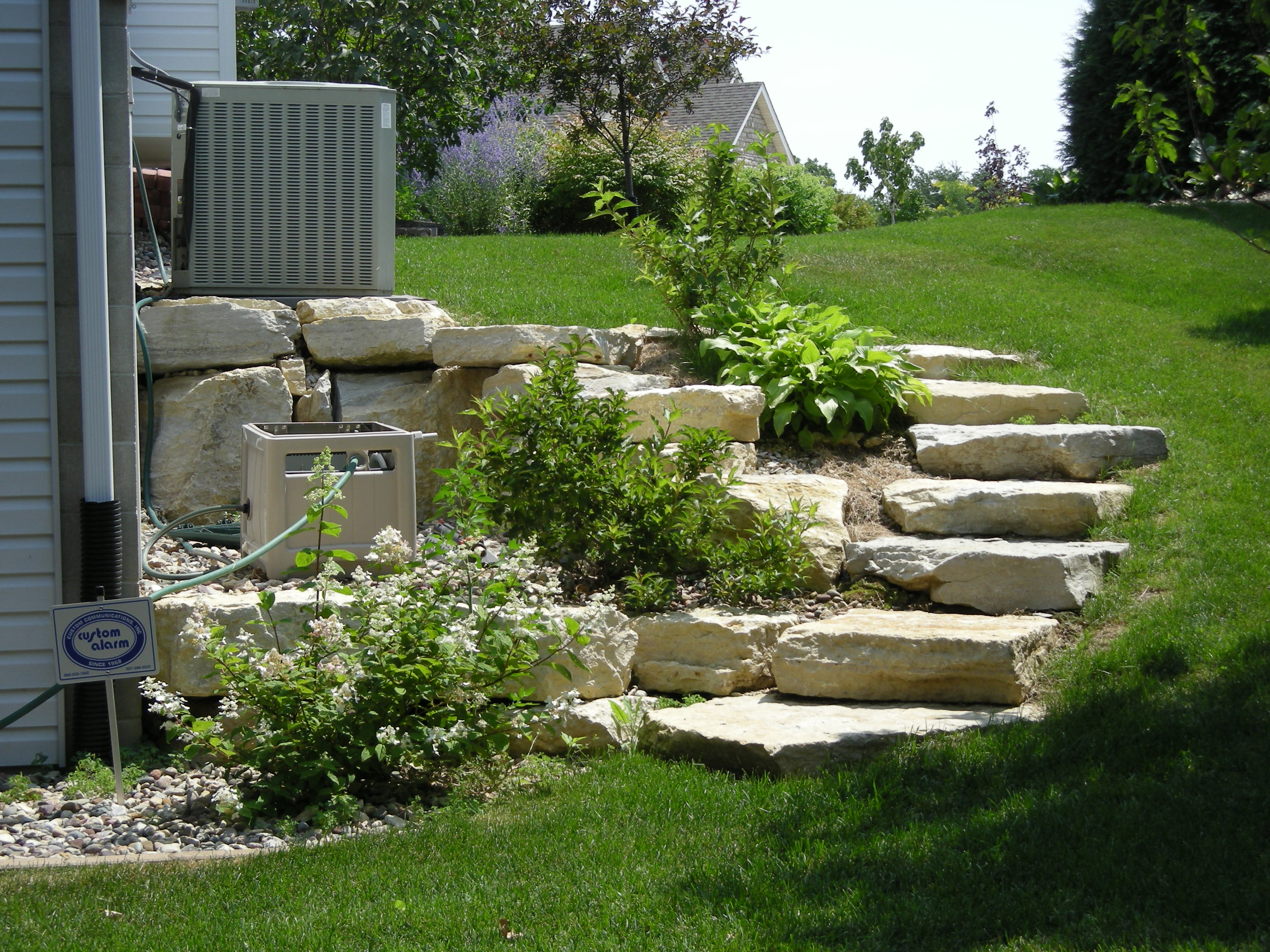 Landscape Designs for Hilly or Sloping Yards - Badger Land ... on Backyard Stairs Ideas id=85120