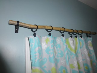 The bamboo curtain rod has a lot more character than something store bought, and it nicely complements the Japanese kimono that hangs on the opposite wall.