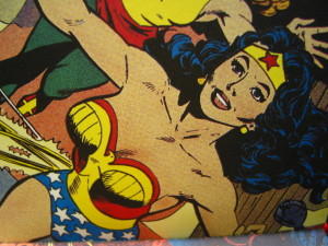 Wonder Woman comic panel, diagonal from bottom left to top right, smiling.
