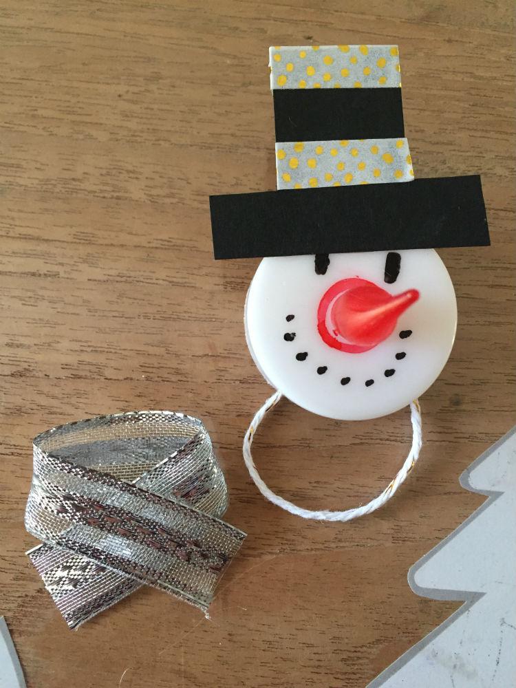 DIY sneeuwpop of sneeuwman van een theelichtje