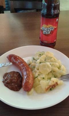 Käsekrainer with mustard and potato salad