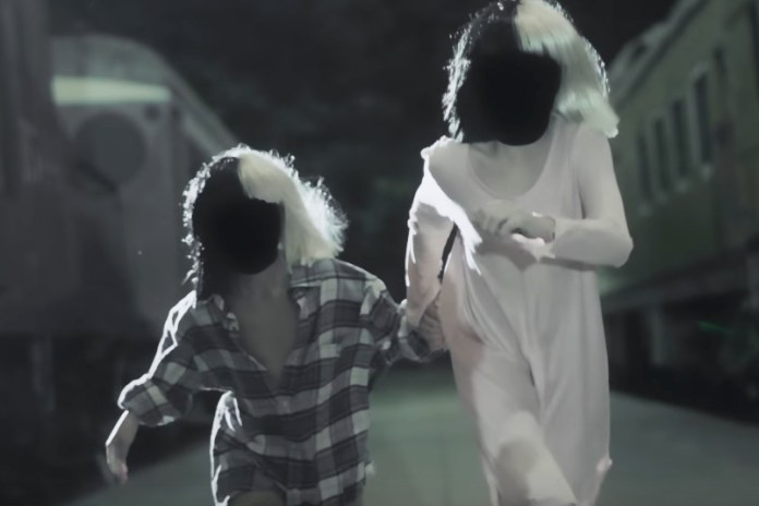 "Watch Sia's Eerie New Video For ""Never Give Up"" Starring Maddie Ziegler"