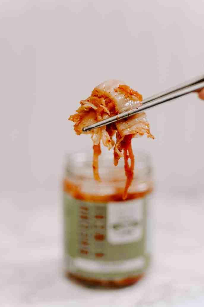 Chopstick picking up kimchi