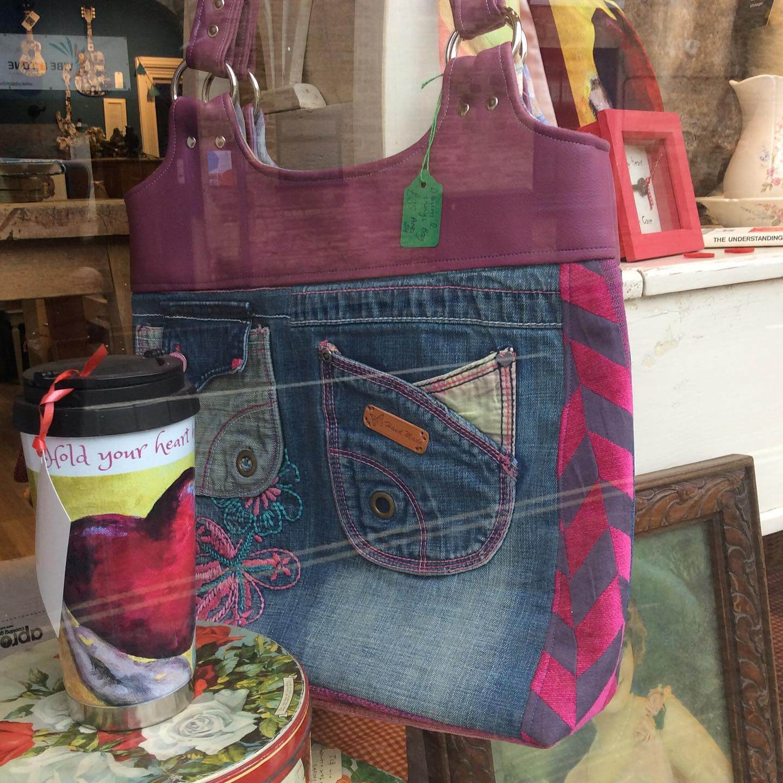 Handmade denim bag hanging up in a shop