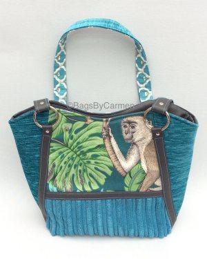 blue monkey handbag