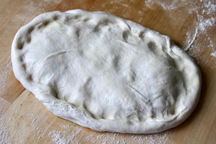 Pizzadej formning hjemmelavet pizza pizzabund