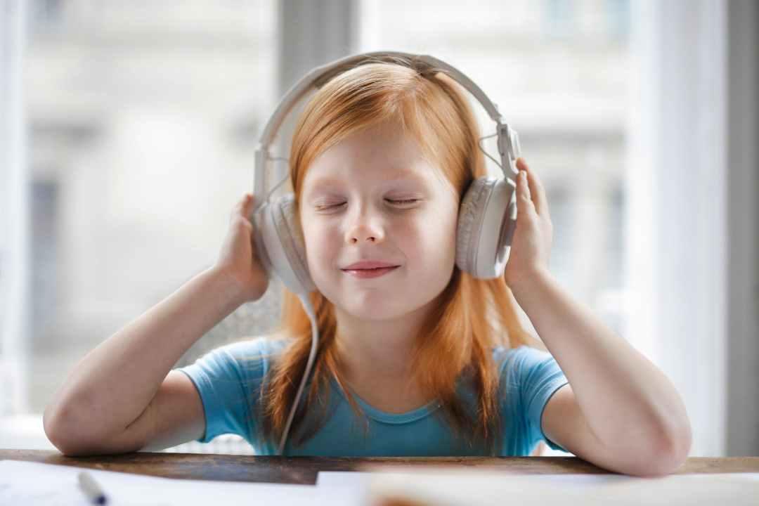 photo of girl listening to music