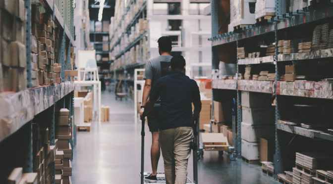 men going around a warehouse