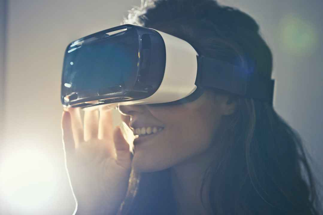 man wearing white virtual reality goggles