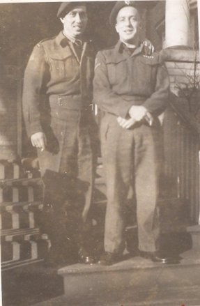 Uncle Bill on the left: his black tie peeking from under his uniform.