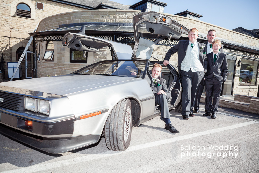 Groom and groomsmen with Delorean car