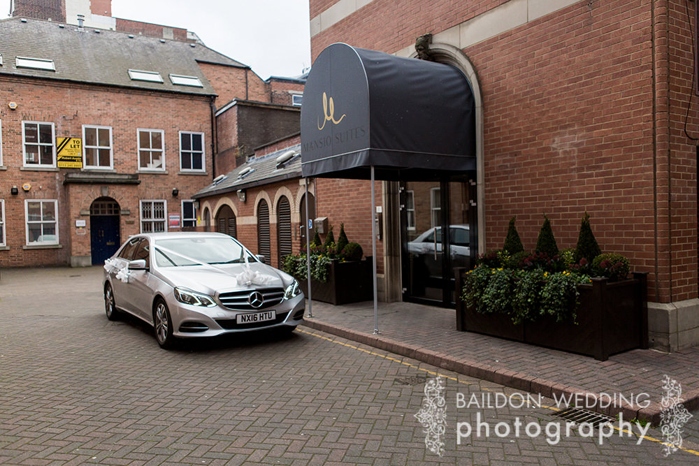 Luxury car outside Mansio Suites
