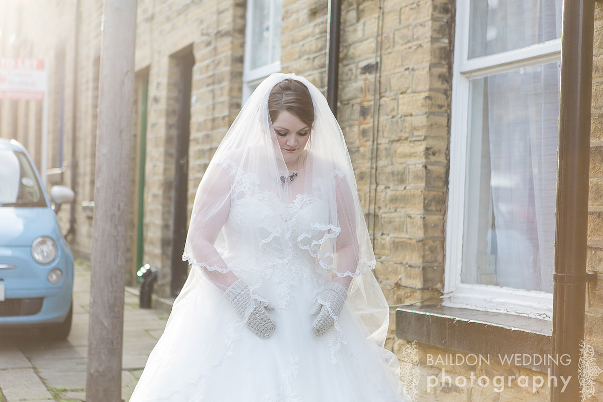 bride in Saltaire village street good light mittens