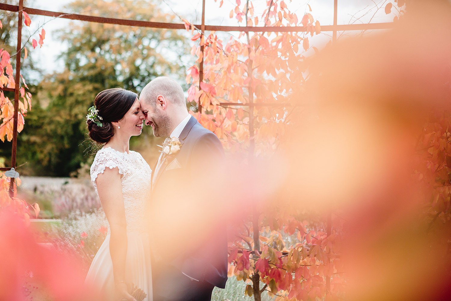Leeds wedding photographer captures newlyweds through Autumnal leaves