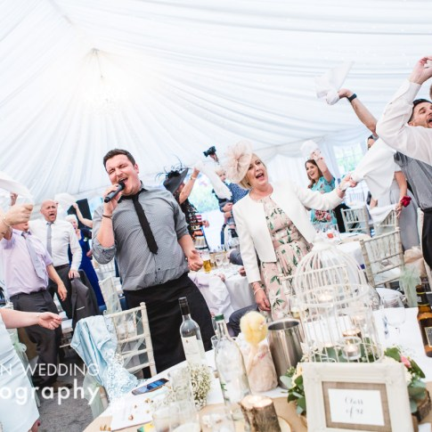 Undercover waiters singing during wedding breakfast. Guests singing and dancing at Leeds wedding