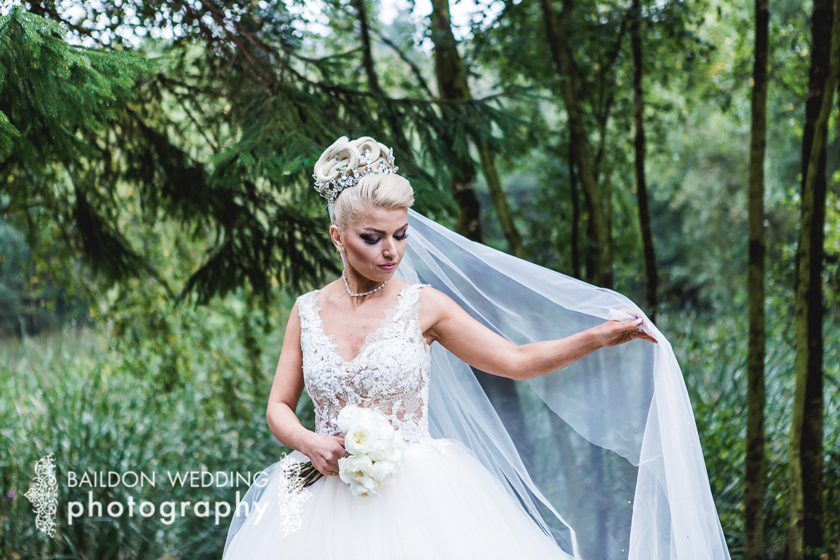 Bride in the grounds of Otley Chevin Country Park wedding venue in Leeds