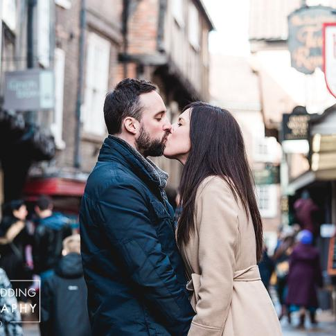 Couple kissing in the shambles during their engagement shoot in York