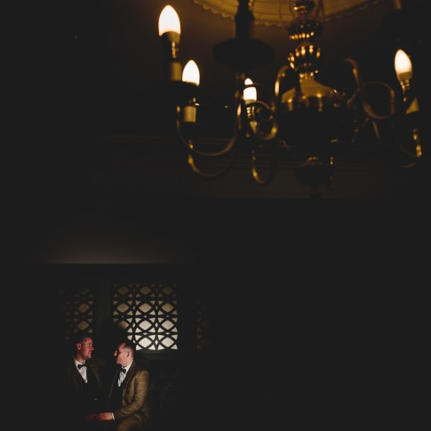 Gay couple lit in darkness during their winter wedding in Yorkshire
